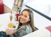 Young woman in the diner Royalty Free Stock Photography