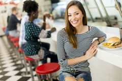 Young woman in the diner Stock Photos