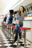 Young woman in the diner Royalty Free Stock Photos