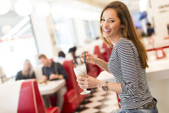 Young woman in diner Royalty Free Stock Images