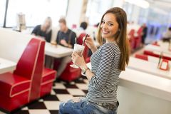Young woman in diner Stock Images
