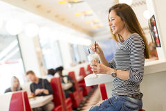 Young woman in diner Stock Photo
