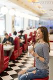 Young woman in diner Royalty Free Stock Photo