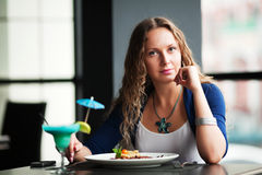 Young woman dining. Stock Images