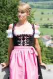 Young woman in a dirndl Stock Photography