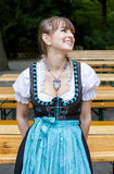 Young woman in dirndl royalty free stock photography