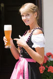 Young woman in dirndl with white beer Stock Photos