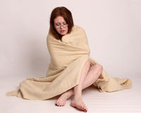 Young woman disaster survivor wrapped in a blanket Royalty Free Stock Images