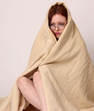 Young woman disaster survivor wrapped in a blanket Stock Photo