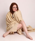 Young woman disaster survivor wrapped in a blanket Royalty Free Stock Photos