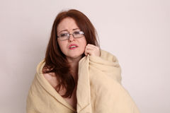 Young woman disaster survivor wrapped in a blanket Stock Photos
