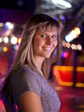 Young woman in a disco. Is smiling Stock Images