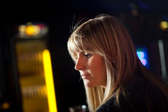 Young woman in a disco. Is sad Royalty Free Stock Photo
