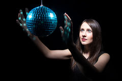 Young woman with disco ball Stock Photo