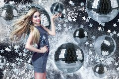 Young woman with disco balls Stock Images
