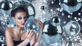 Young woman with disco balls Stock Photos
