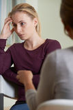 Young Woman Discussing Problems With Counselor Stock Images