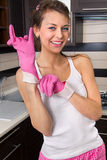 Young woman with dish gloves Royalty Free Stock Image