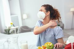 Young woman displaying food allergy symptoms stock image