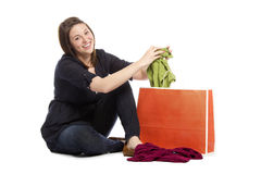 Young woman displaying her new green top Royalty Free Stock Image