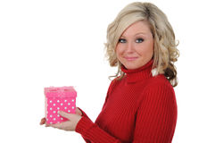 Young Woman Displaying a Pink Gift Box. Royalty Free Stock Images