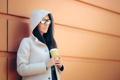 Cool Urban Fashion Girl With Hooded Coat and Coffee Stock Photo