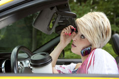 Young Woman Distracted While Driving Royalty Free Stock Photos