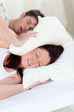 Young woman disturbed by her boyfriend's snores Royalty Free Stock Photo