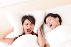 Young woman disturbed by the snores of her husband Stock Images