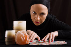 Young woman with divination cards Royalty Free Stock Photos