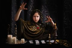 Young woman with divination cards. In room Stock Photo