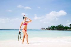 Young woman in divind equipment on the sea Royalty Free Stock Image