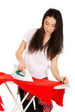 Young woman do the ironing. Stock Photography