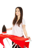 Young woman do the ironing. Stock Images