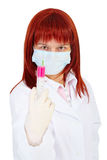 Young woman - doctor armed with large syringe Royalty Free Stock Images