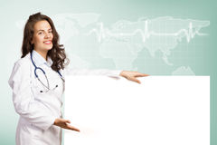 Young woman doctor with a blank banner Stock Photos