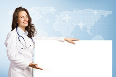 Young woman doctor with a blank banner Royalty Free Stock Images