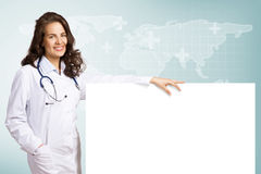 Young woman doctor with a blank banner Stock Image