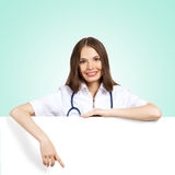 Young woman doctor with a blank banner Stock Images
