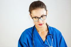 Young woman doctor in blue coat and with a stethoscope royalty free stock photo