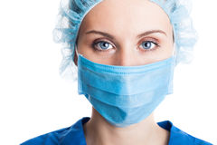 Young woman doctor in cap and face mask Stock Photos