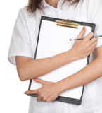 Young woman doctor with clipboard and pen Stock Photo