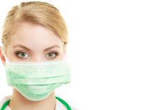 Young woman doctor in face surgical mask Royalty Free Stock Photography