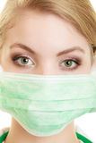 Young woman doctor in face surgical mask Royalty Free Stock Photos