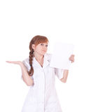 Young woman doctor is holding blank paper. Royalty Free Stock Photos