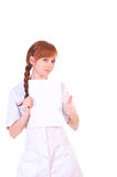 Young woman doctor is holding blank paper. Stock Photos