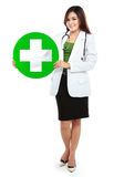 Young woman doctor holding medical sign Stock Image