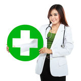 Young woman doctor holding medical sign Royalty Free Stock Images