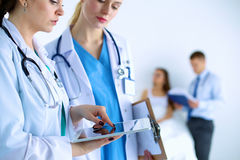 Young woman  doctor holding a tablet pc Royalty Free Stock Photo