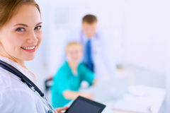Young woman  doctor holding a tablet pc Royalty Free Stock Images